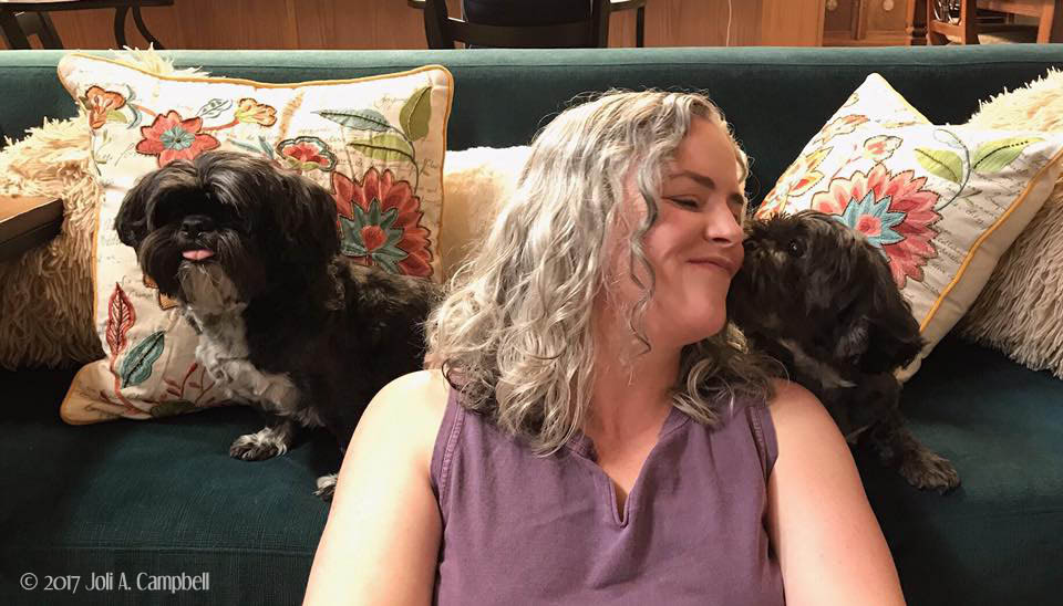 image of Joli Campbell with her dogs