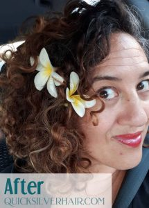 Image of Vanessa with flwoers in her curly hair