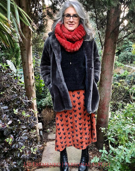 Image of liz in heart print skirt with fleece and boots