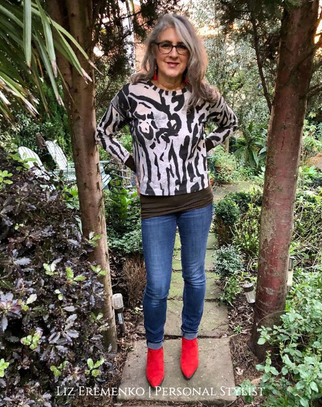 Image of Liz in leaopard print sweater and red boots