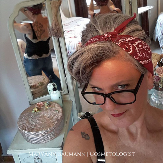 image of woman with pixie cut and red bandana