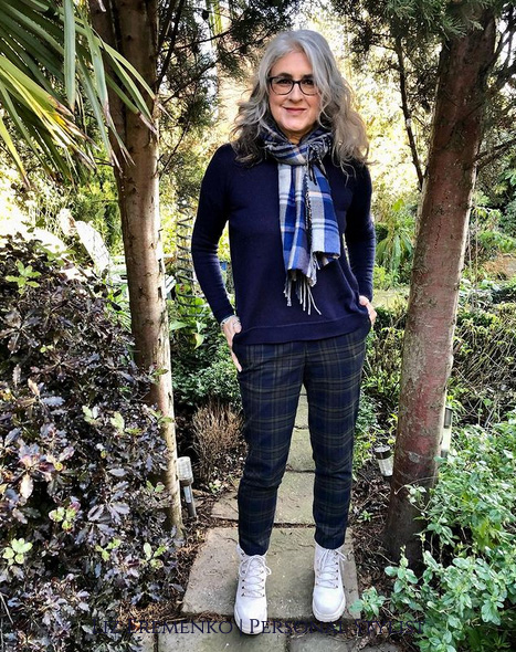 Image of Liz in navy sweater with blue check trousers
