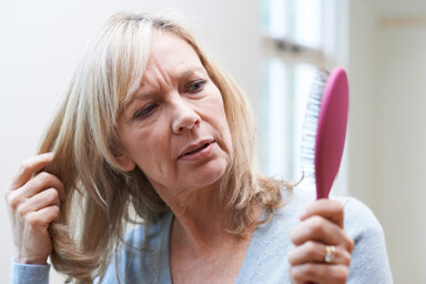 image of a woman concerned about hair loss
