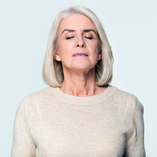 Great Fragrance-Free Hair Care Products image of woman taking deep breath